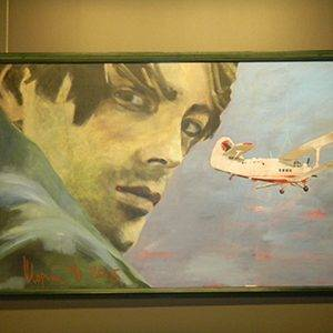 Painting of man and airplane