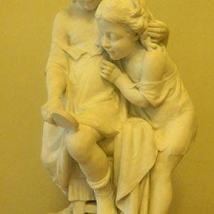 sculpture of 2 girls with mirror