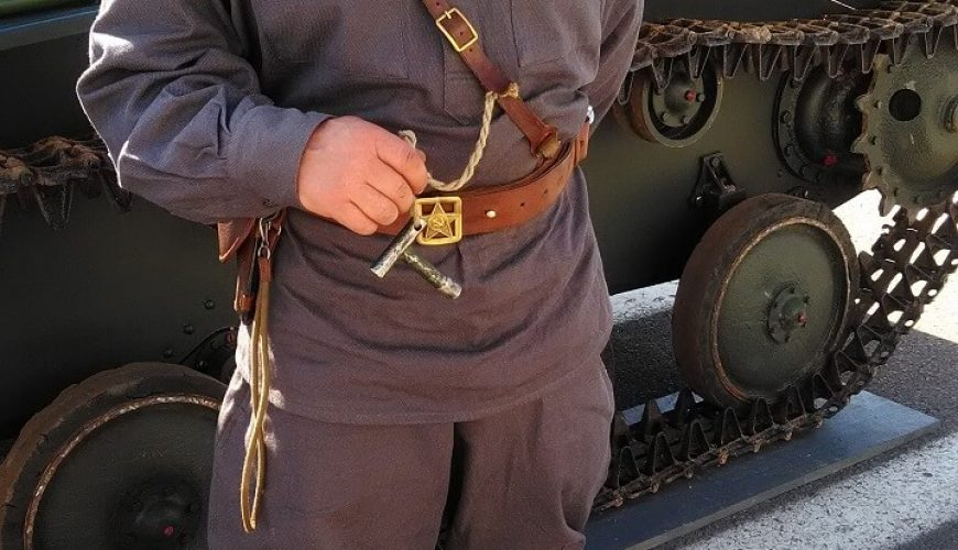 soldier next to tank