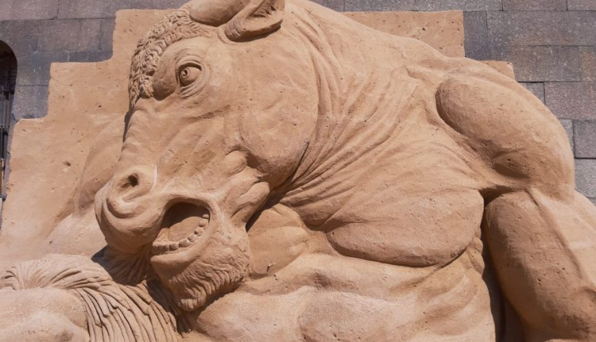 sand sculpture of bull