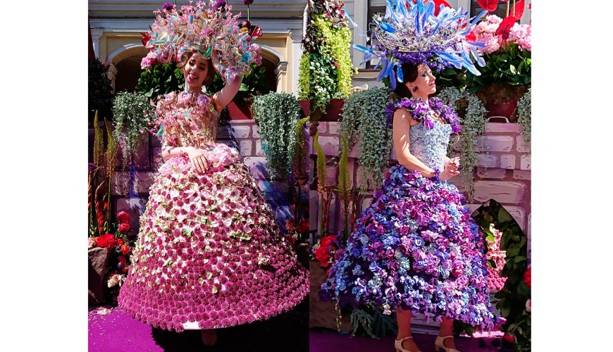 2 women wearing dresses made with flowers